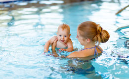 Mother and baby swim  in pool. Mother and baby swim  in the pool Royalty Free Stock Photography