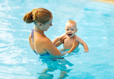 Mother and baby swim  in pool. Mother and baby swim  in the pool Royalty Free Stock Images
