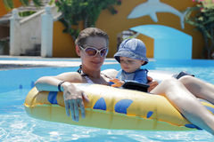 Mother with baby on swim ring Royalty Free Stock Photos