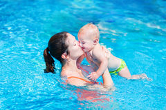 Mother and baby in swimming pool Royalty Free Stock Images