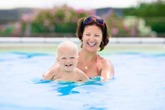 Mother and baby in swimming pool Stock Image