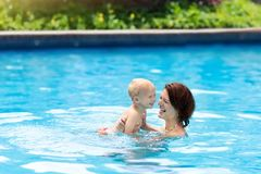 Mother and baby in swimming pool Stock Photo