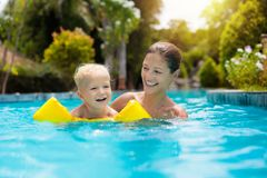 Mother and baby in swimming pool Royalty Free Stock Photo