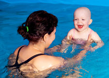 Mother and baby swimming Royalty Free Stock Photos