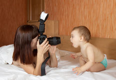 Mother with baby takes photo Stock Image