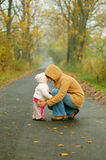 Mother and baby. Taking and afternoon walk in the park stock image