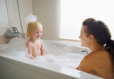 Mother and baby taking bath Royalty Free Stock Images