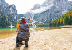 Mother and baby taking photo while on lake braies Royalty Free Stock Photography
