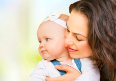 Mother and baby together Stock Photos
