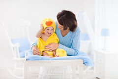 Mother and baby in towel after bath Royalty Free Stock Image