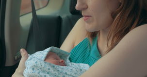 Mother with baby travelling by car stock footage