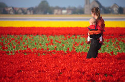 Mother and Baby in Tulip Field Royalty Free Stock Photos