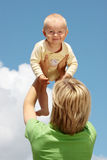 Mother with baby under blue sky Royalty Free Stock Photo