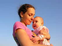 Mother with baby under sky. Mother with baby under blue sky royalty free stock image