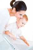 Mother and baby using laptop Stock Photography