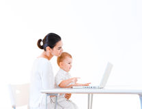 Mother and baby using laptop Stock Images