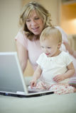 Mother and baby using laptop Royalty Free Stock Photography