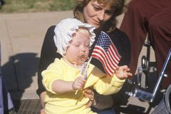 Mother and Baby on Veteran's Day Parade Stock Photography