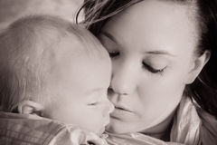 Mother with baby. Vintage rendition of a mother holding her baby close Royalty Free Stock Photos