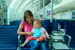 Mother and baby waiting in the airport Royalty Free Stock Images