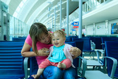 Mother and baby waiting in the airport Stock Photos