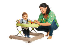 Mother and baby in walker Stock Photo