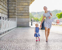 Mother and baby walking in city Stock Images
