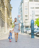 Mother and baby walking in city Royalty Free Stock Image