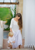 Mother and baby walking up stairs Stock Photo