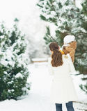 Mother and baby walking in winter park . rear view Stock Photography