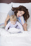 Mother and baby watching tablet Stock Photography