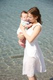 Mother and baby on water background Royalty Free Stock Images