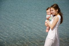 Mother and baby on water background Royalty Free Stock Photos