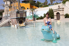 Mother and baby in water park Stock Photos