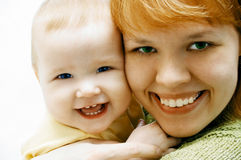 Mother and baby on white Stock Photos