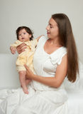 Mother and baby on white Royalty Free Stock Images