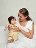 Mother and baby on white Royalty Free Stock Photography