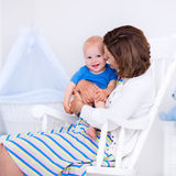 Mother and baby in white bedroom Stock Photo
