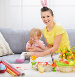 Mother with baby who like cookies a lot Stock Photo