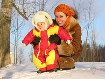 Mother with baby winter Royalty Free Stock Image
