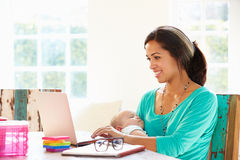 Mother With Baby Working In Office At Home Royalty Free Stock Image
