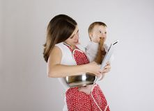 Mother and baby. Young mother is looking at tablet with her baby Royalty Free Stock Images