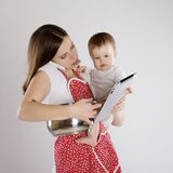 Mother and baby. Young mother is looking at tablet with her baby Stock Photo