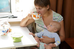 Mother with baby on your lap Royalty Free Stock Image