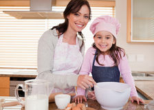 Mother baking with her daughter Royalty Free Stock Photography