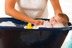 Mother is bathing her baby. (just hands stock photo