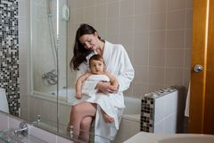 Mother in a Bathrobe and with a child Royalty Free Stock Image