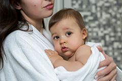 Mother in a Bathrobe and with a child Stock Photo