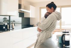 Mother in a bathrobe holding a baby boy in her arms Stock Photos