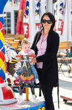 Mother and bay at funfair Royalty Free Stock Images